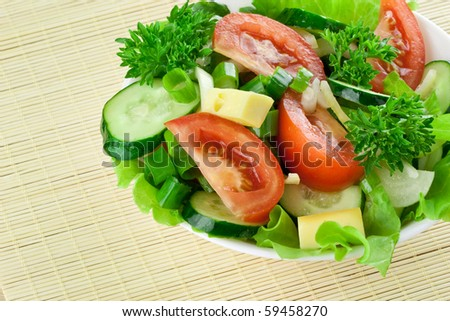 Healthy salad with tomato, cucumber, cheese - stock photo