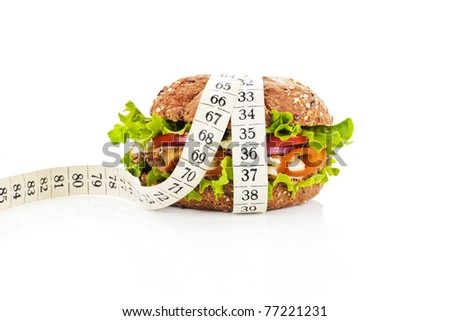Healthy sandwich with fresh vegetables and cheese and measuring tape isolated on white. Fitness concept. - stock photo