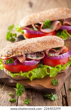 healthy sandwich with ham tomato and lettuce - stock photo