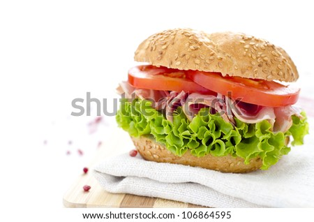 Healthy sandwich with ham tomato and salad - stock photo
