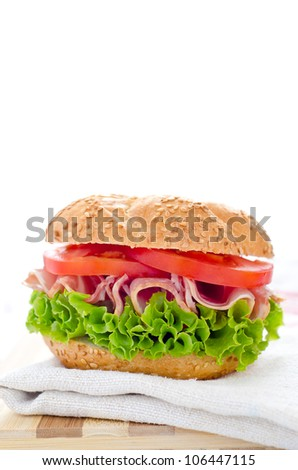 Healthy sandwich with ham tomato and salad with white space - stock photo