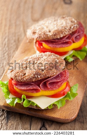 healthy sandwich with salami tomato pepper and lettuce  - stock photo