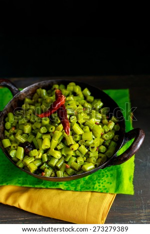 Healthy Sauteed Green Beans  A side dish of Cooked Green beans cooked in an Indian Wok  - stock photo