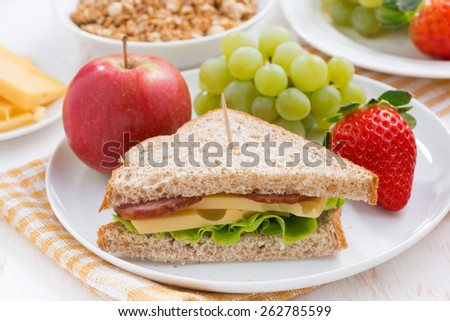 healthy school breakfast with fresh fruits and vegetables, close-up, horizontal - stock photo