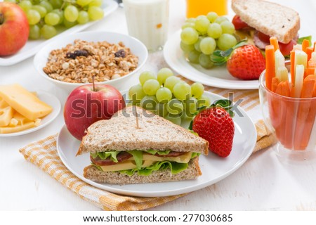 healthy school breakfast with fresh fruits and vegetables, horizontal - stock photo