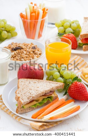 healthy school breakfast with fruits and vegetables, vertical, top view
