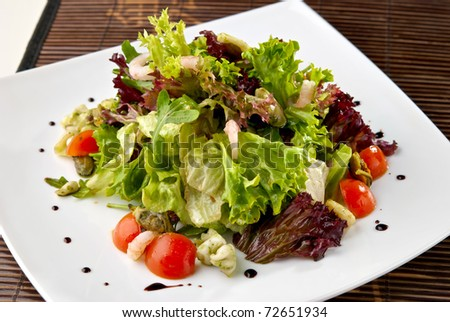 Healthy Seafood Salad with shrimps,octopus, mussels and cherry tomatoes. Indoor. - stock photo