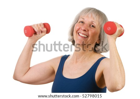 Healthy senior woman in her sixties lifting hand weights with great spirit and cheer - stock photo