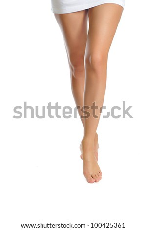 healthy sexy slander female legs making step isolated on white background