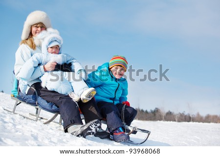 Healthy sledging activities on the snowy hill - stock photo