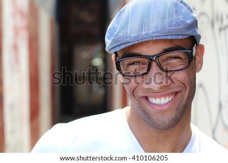 Healthy Smile. Teeth Whitening. Beautiful Smiling Young man Portrait close up. Over modern corridor background . Laughing businessman with Perfect Shin. Copy space for text.