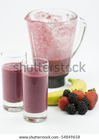 Healthy smoothie with strawberries, banana and blackberries. - stock photo