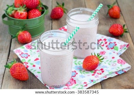 Healthy smoothie with strawberry, banana and yogurt in glass jar - stock photo