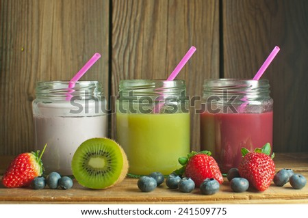 Healthy smoothies in jars  - stock photo