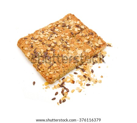 Healthy Snack : Cereal Bars : germinate rice whole grains with fruits on white background, Multigrain Bar - stock photo