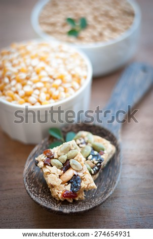 Healthy Snack : Cereal Bars : germinate rice whole grains with fruits on wooden board, Multigrain Bar - stock photo