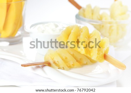 Healthy snack - Pineapple skewer with curd cheese or yogurt - stock photo