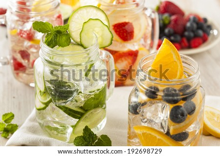 Healthy Spa Water with Fruit on a Background - stock photo