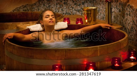 Healthy Spa: Young Beautiful Relaxing Woman Sitting in the Japanese Phyto Barrel and Having Spa Treatment - stock photo