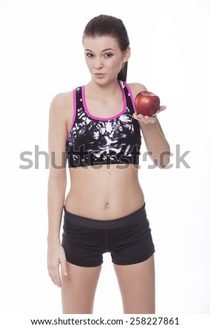 Healthy sporty girl with red apple in white background