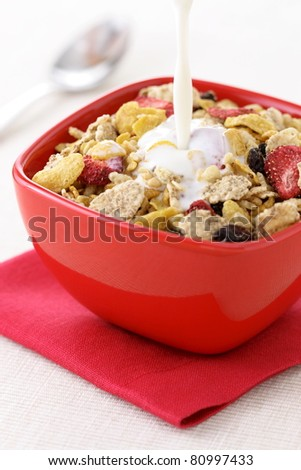 healthy strawberries and riceflakes cereal with milk, part of a healthy nutrition program.  milk in mottion. - stock photo