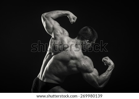 Healthy, strong, muscular man on a black background.