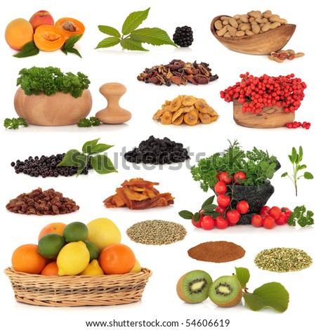 Healthy super food collection of fresh and dried fruit, nuts, herbs, spices, and pulses, very high in antioxidants and vitamins, isolated over white background. - stock photo