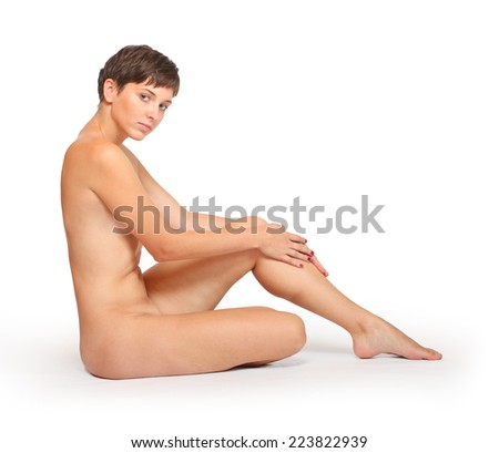 Healthy tanned woman with perfect body over white. - stock photo