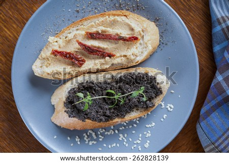 Healthy tasty sandwiches with hummus and tapenade - stock photo