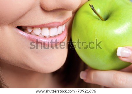 healthy teeth and green apple, close up - stock photo