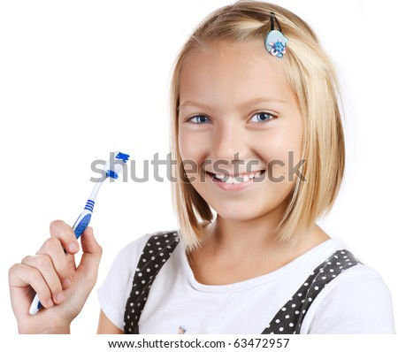 Healthy Teeth. Little Girl brushing her teeth - stock photo