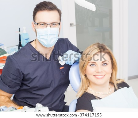 Healthy teeth patient at dentist office dental caries prevention. - stock photo
