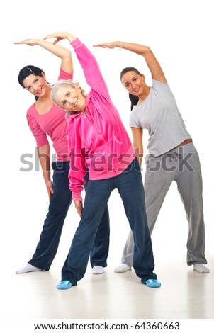 Healthy three women workout and stretching hands  over white background - stock photo