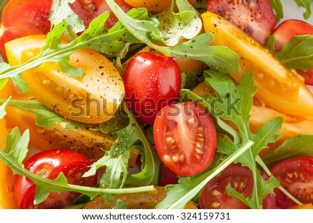 healthy tomato salad with arugula  - stock photo