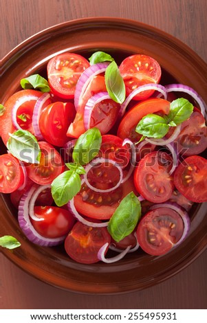 healthy tomato salad with onion basil olive oil and balsamic vinegar - stock photo