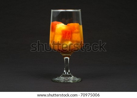 Healthy Tropical Fruit Cocktail with Papaya and Pineapple Isolated on a Black Background