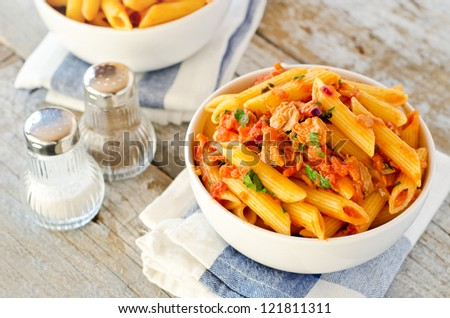 Healthy tuna and tomato penne pasta - stock photo