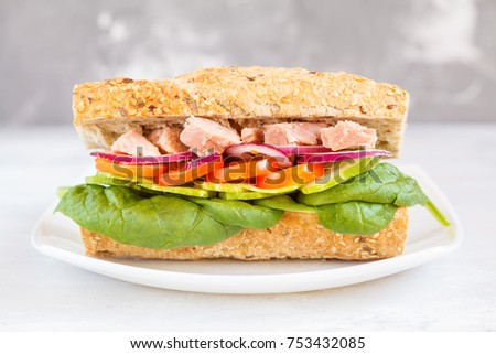Healthy tuna sandwich with vegetables and rye baguette, macro