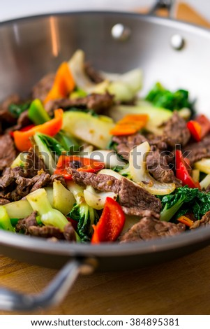 Healthy vegetable & beef stir-fry. Made with flank steak, peppers, onions and bok choy stir fried in an asian wok.
