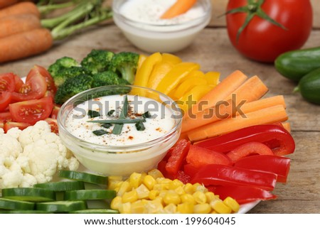 Healthy vegetable food plate with paprika, carrots and tomatoes with dip for eating - stock photo