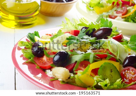 Healthy vegetable homemade tasty fresh organic salad on the white table - stock photo