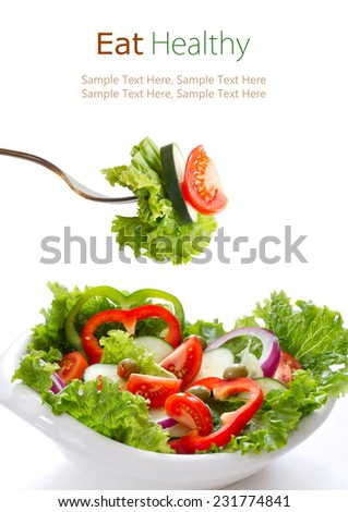 Healthy vegetable salad in a white bowl and on fork. Isolated on white.