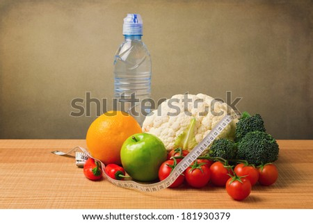 Healthy vegetables and fruits on wooden table. Diet concept - stock photo
