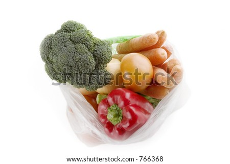Healthy vegetables in a clear plastic grocery bag on a white background - stock photo