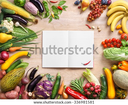 Healthy vegetables on a wooden background and notebook. Fresh vegetables background. Diet. Dieting. Space for your text. high resolution product - stock photo