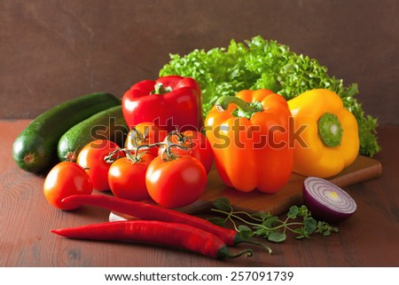 healthy vegetables pepper tomato salad onion chilli on rustic background - stock photo