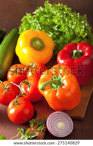 healthy vegetables pepper tomato salad onion on rustic background - stock photo