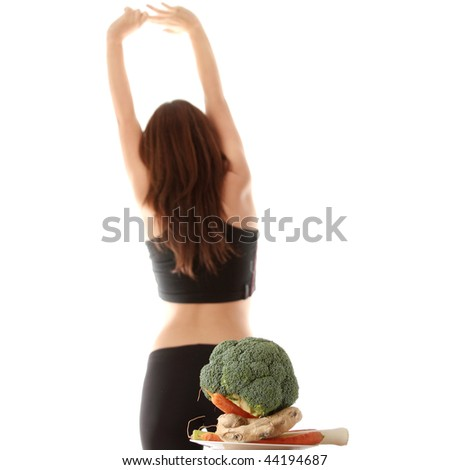 Healthy vegetables with fitness girl in background, isolated o white - stock photo