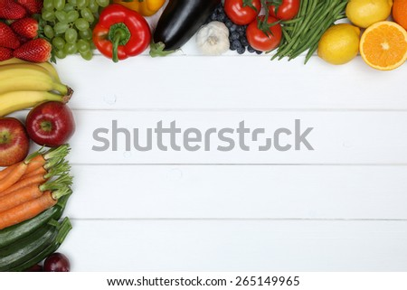 Healthy vegetarian and vegan eating vegetables and fruits like apple, orange, tomato with copyspace - stock photo