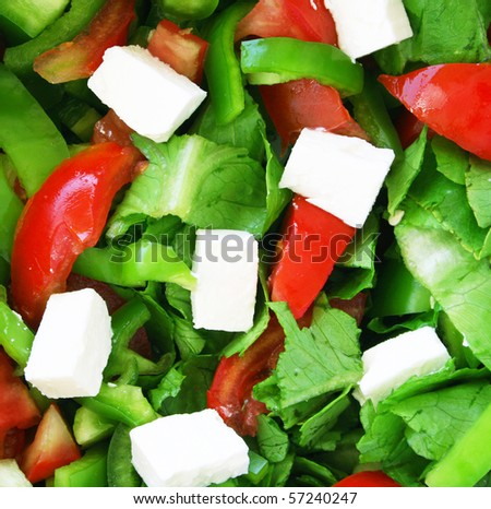 Healthy vegetarian greek salad background - stock photo